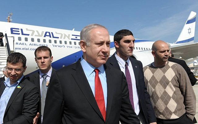 Prime Minister Benjamin Netanyahu in Ben Gurion airport after his return from his visit to Canada and the United States (photo credit: Amos Ben Gershom/GPO/Flash90)