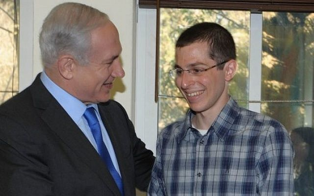 Prime Minister Benjamin Netanyahu meets Gilad Shalit in Tel Avivon March 29, 2012. (photo credit: Moshe Milner/ GPO / Flash90)