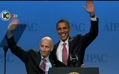 Image capture of US President Barack Obama embracing AIPAC chairman Lee Rosenberg(photo credit: Channel 10)