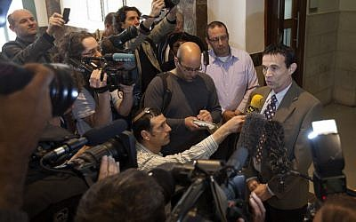 Oded Golan speaks to reporters after his acquittal Wednesday in Jerusalem's District Court (photo credit: AP Photo/Sebastian Scheiner)