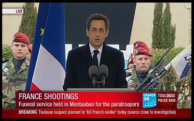 French President Nicolas Sarkozy speaks at the memorial service for slain soldiers on Wednesday. (photo credit: screen capture France 24)