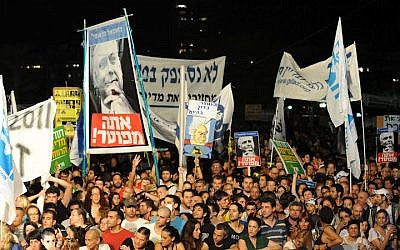 'The people demand social justice' was a catchphrase of the social protests that erupted around the country in the summer of 2011. The Trajtenberg Committee was established following the protests. (photo credit: David Katz/The Israel Project)