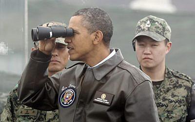 US President Barack Obama tours the military border between the two Koreas, in Panmunjom, South Korea, in March 2012 (AP/Pablo Martinez Monsivais)