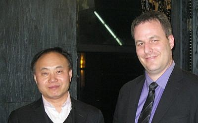 Danny Denan, chairman of Enerpoint Israel (right), with Dr. Zhengrong Shi, chairman of Suntech, after the two signed a recent deal to market Suntech's Super-Poly system in Israel (photo credit: Courtesy)