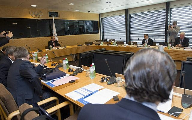 President of the IOC Belgian Jacques Rogge, background left, and members of the board wait for a meeting of the executive board in Lausanne, Switzerland, Tuesday (photo credit: Salvatore Di Nolfi, AP Photo/Keystone)