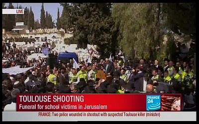 Image capture of Jerusalem funeral of victims killed in Toulouse Jewish school killing (photo credit: France 24)