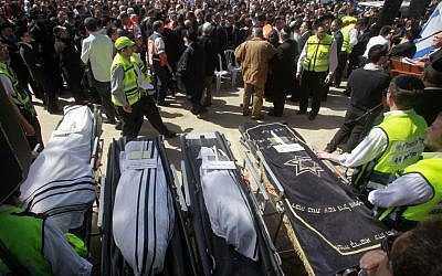 The bodies of the Toulouse Jewish school shooting victims, shrouded in prayer shawls, prior to burial at the Givat Shaul cemetery in Jerusalem, March 2012. (photo credit: Uri Lenz/Flash90)