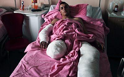 Muhammed Ibrahim, 18, lies in the Kemal Ataturk University hospital in Antakya, Turkey, on Thursday (photo credit: AP Photo/Gaia Anderson)