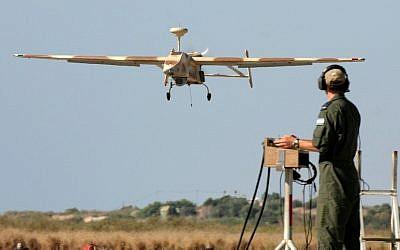 A 'Searcher II' (Kochav Lavan) UAV returns from a reconnaissance mission. (photo credit: Tsahi Ben-Ami/Flash90)