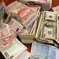 Illustrative photo of foreign currencies. (Yossi Zamir/Flash90)