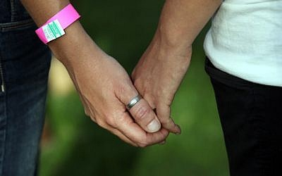 Female participants hold hands during a gay pride parade in Jerusalem (photo credit: Yossi Zamir/Flash90/File)