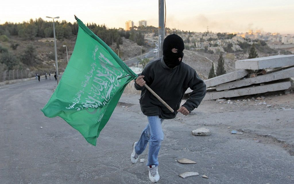 A Jerusalem youth carries the Hamas flag (photo credit: Nati Shohat/Flash90)