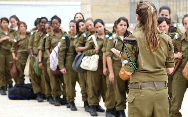 Female soldiers line up before their commander (photo credit:Nicky Kelvin/Flash90)