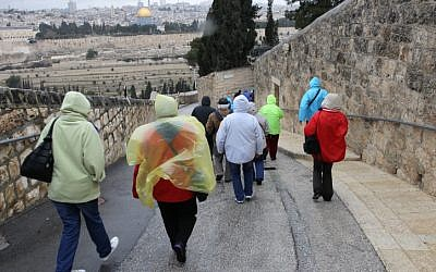 Tourists walk down Mount of Olives towards the Old City of Jerusalem in February 2012. (photo credit: Nati Shohat/Flash90)