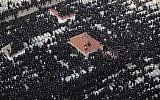 Thousands of ultra-Orthodox men attend the funeral of Rabbi Moshe Yehoshua Hager in Bnei Brak (photo credit: Yaakov Nahomie/Flash90)
