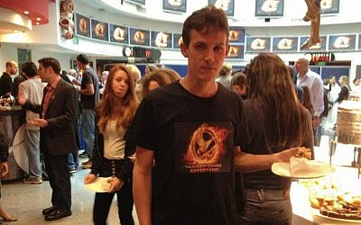 A Funtactix employee sports a T-shirt with the logo of The Hunger Games Adventures online game (Photo credit: Courtesy)