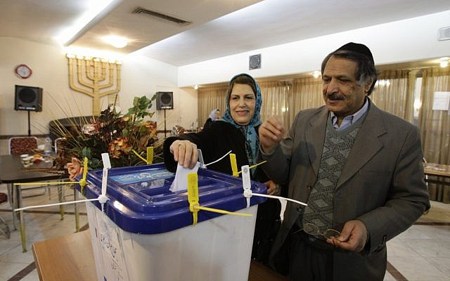 An Iranian Jewish couple casts their ballots for the parliamentary elections, in their polling station, in Tehran, Iran on Friday, March 2, 2012. Under the Iranian constitution Jewish community has one representative in the parliament (photo credit: AP/Vahid Salemi)
