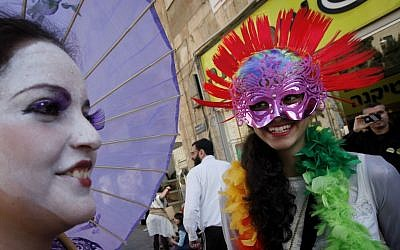 Masks on the streets of Jerusalem (photo credit: Miriam Alster/Flash90)