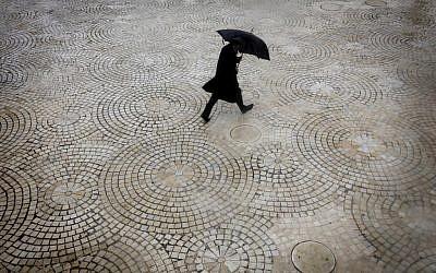 Rainy day gear (photo credit: Miriam Alster/Flash90)