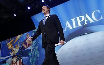 Republican presidential candidate, former Pennsylvania Sen. Rick Santorum, arrives to speak before the American Israel Public Affairs Committee (AIPAC), in Washington, on Tuesday. (photo credit: AP/Charles Dharapak)