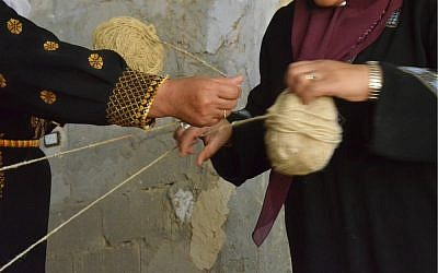 Wrapping skeins of wool (photo credit: Elio Nudelman)