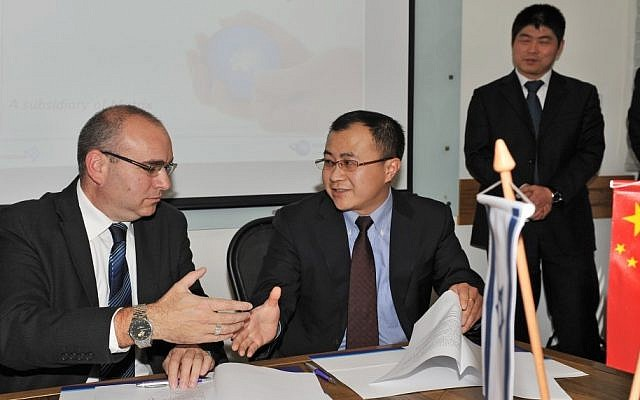 Left to right: Eran Lesser, co-chairman of Matrix and John Bryce Training, with Stone Shi, deputy administrator of the Wujin high-tech industrial zone in Changzhou (photo credit: Courtesy)