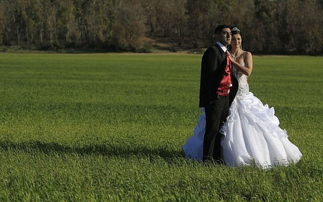 Illustrative photo of a couple posing before their wedding, March 2012. (Tsafrir Abayov/Flash90)