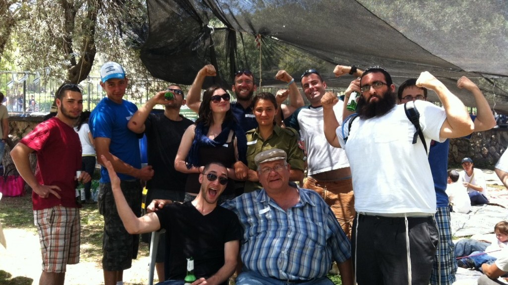 "Tziki Aud, center, and his lone soldier ""children"" at the Sacher Park barbecue in Jerusalem, April 26, 2012 (photo credit: Greg Tepper/Times of Israel)"