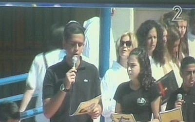 Students and teachers participated in a Holocaust Remembrance Day ceremony at the Ashdod high school where Sarah Malka was a teacher. (photo credit: screenshot courtesy Channel 2)