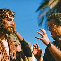Mel Gibson, right, directs Jim Caviezel on the set of Gibson's movie 'The Passion of The Christ' in 2003 (AP/Icon Productions, File)