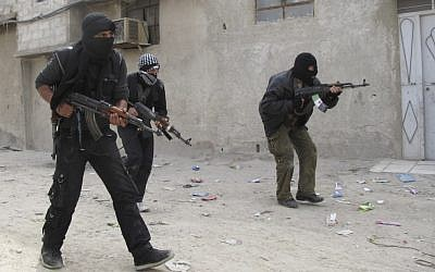Free Syrian Army fighters train in a neighborhood of Damascus. (photo credit: AP)