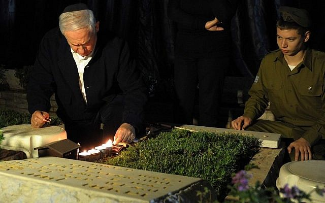Benjamin Netanyahu visits the grave of his brother Jonathan, who was killed in action (photo credit: Avi Ohayon/GPO)