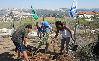 Public Advocate Bill de Blasio (center) planting a tree with wife Chirlane McCray (right) and son Dante (left) in the town of Yad Assa, just outside of Jerusalem. (photo credit: Flickr/Public Advocate Bill de Blasio)