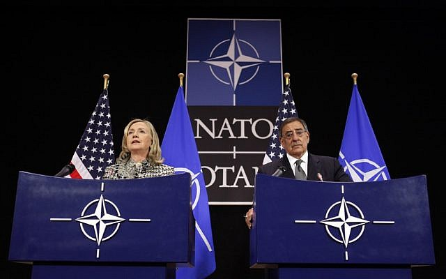 US Secretary of State Hillary Rodham Clinton and Defense Secretary Leon Panetta hold a news conference at NATO Headquarters in Brussels, Belgium, Wednesday (photo credit: AP/Jacquelyn Martin)  Summary