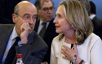 "France's Foreign Minister Alain Juppe speaks with US Secretary of State Hillary Rodham Clinton at the start of an ""ad hoc"" meeting on Syria, in Paris, in April. (photo credit: Jacquelyn Martin/AP)"