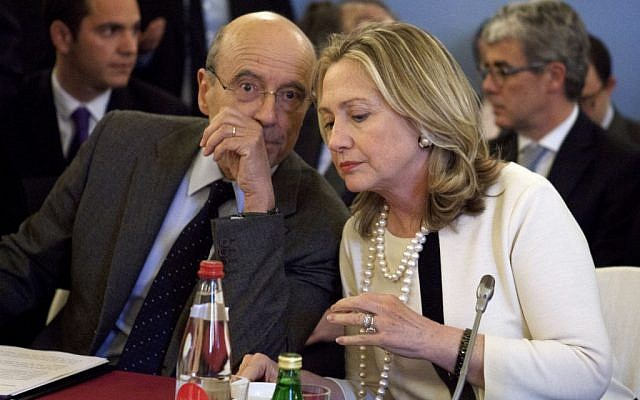 US Secretary of State Hillary Rodham Clinton speaks with French Foreign Minister Alain Juppe in Paris on Thursday, during a meeting on Syria. (photo credit: Jacquelyn Martin/AP)