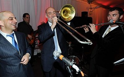 Israeli UN envoy Ron Prosor plays the trombone during his rendition of 'When I'm 64' on Israel's 64th Independence Day. (photo credit: Shahar Azran/Permanent Mission of Israel to the United Nations)