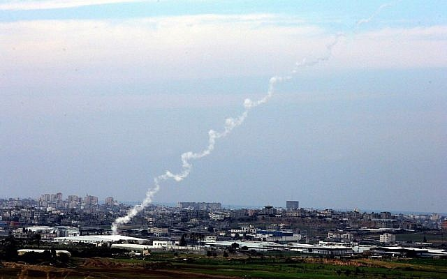 Illustrative photo of two Kassam rockets heading toward Israel shortly after they are fired by Palestinians in Gaza. (photo credit: Edi Israel/Flash90/File)