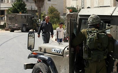 IDF soldiers patrol the streets of Ramallah in 2008 (photo credit: Issam Rimawi / Flash 90)