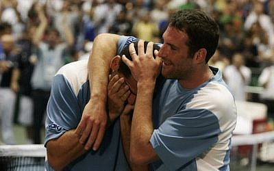Jonathan Erlich, right, with former doubles partner Andy Ram (photo credit: Uri Lenz/Flash90/File)