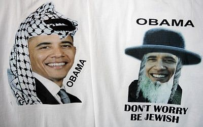 T-shirts in a clothing store in Jerusalem's Old City portray Barack Obama in traditional Arab kaffiyeh and Hassidic hat and sidelocks (photo credit: Abir Sultan/Flash 90)
