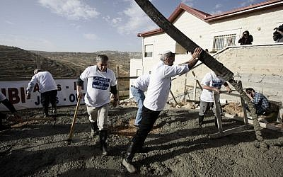 Illustrative photo of settlers building new homes in the West Bank (photo credit: Abir Sultan/Flash90)