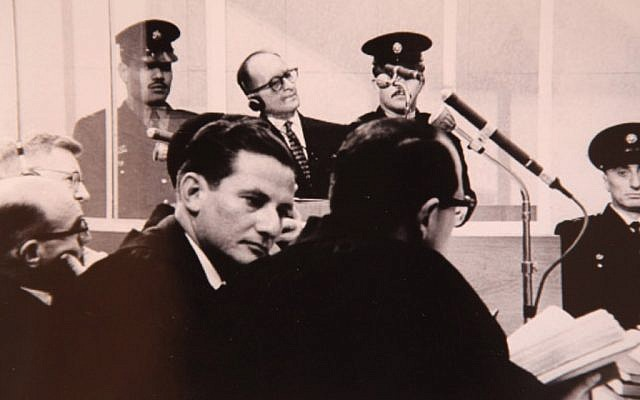 Chief prosecutor of the Eichmann trial, Israeli Attorney Gideon Hausner (left) and Justice Gabriel Bach, senior prosecutor, (middle, facing camera), during Adolf Eichmann's (back) trial in Jerusalem (photo credit: GPO/Flash90)