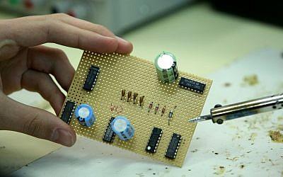 A student designs a chip in Jerusalem (Photo credit: Moshe Shai/Flash90)