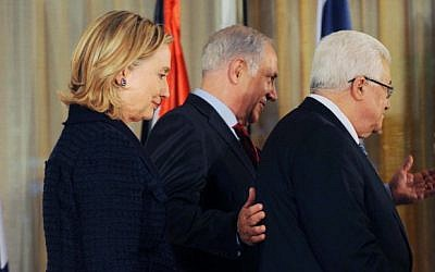 US Secretary of State Hillary Clinton, Prime Minister Benjamin Netanyahu and Palestinian President Mahmoud Abbas meet in Jerusalem in 2010 (photo credit: Avi Ohayon/GPO/Flash90)