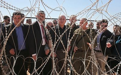 Prime Minister Benjamin Netanyahu (center) and Interior Minister Eli Yishai (2nd left) visit the Israeli-Egyptian border (photo credit: Amit Shabi/Flash90)