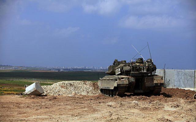 An army tank positioned on the Israel Gaza border (photo credit: Tsafrir Abayov/Flash90)