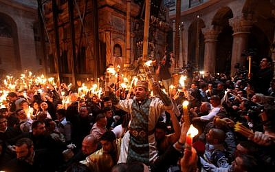 "Christian worshipers take part in the ""Holy Fire"" ceremony at the Church of the Holy Sepulchre in Jerusalem's Old City during Easter, 2011 (photo credit: Kobi Gideon/Flash90)"