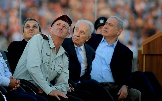 Barak, Gantz, Peres and Netanyahu (from left) during a graduation ceremony of Israeli pilots at the Hatzerim air force base near Beersheba last June. (photo credit: Moshe Milner/Flash90)