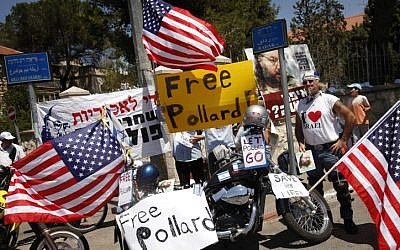Demonstrators hold signs calling for the release of Jonathan Pollard during a demonstration in 2012 (photo credit: Miriam Alster/Flash90)